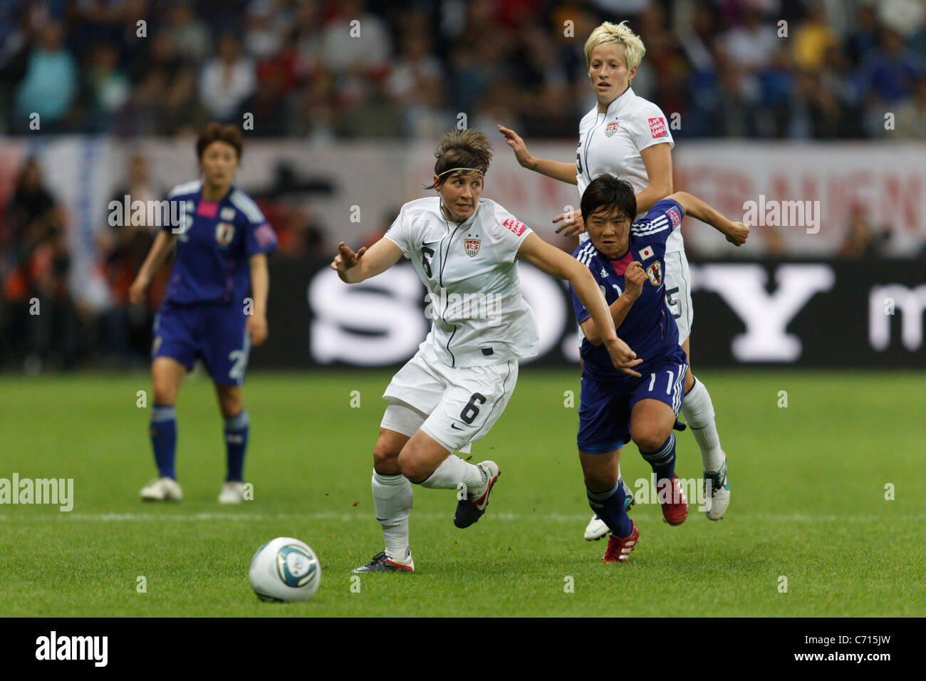 Amy LePeilbet of the United States (6) battles with Shinobu Ohno of Japan (11) during the 2011 FIFA Women's - Stock Image