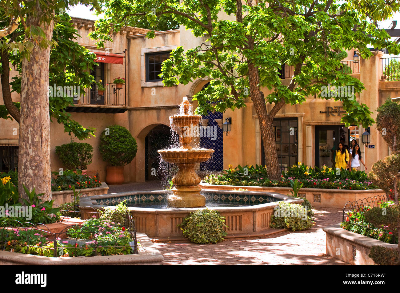 Spanish style tiered fountain patio courtyard Stock Photo
