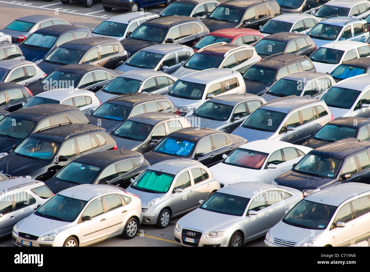 Tightly parked cars in a car park - Stock Image
