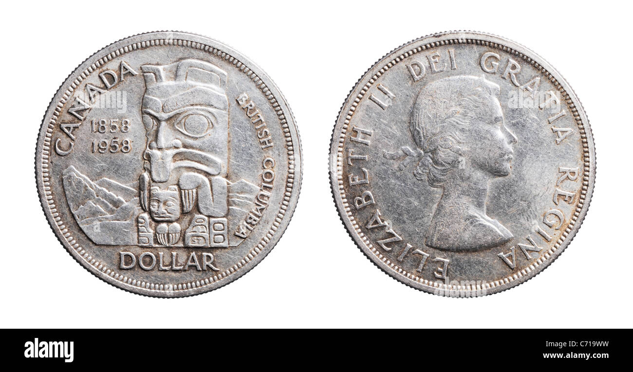 Commemorative Canadian silver coin from 1958 celebrating 100 years of British Columbia. Worn and dirty coin. - Stock Image