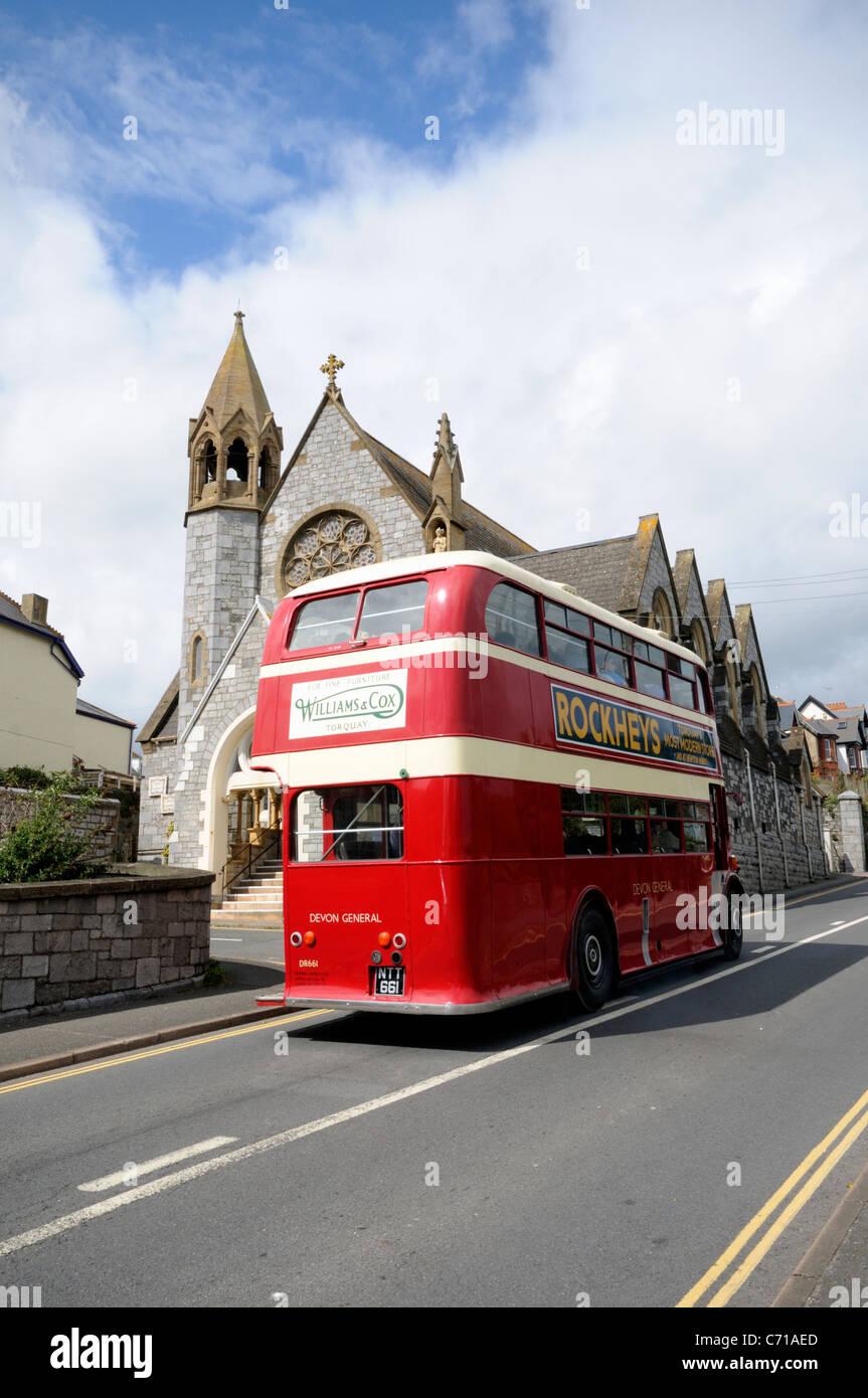 Classic Devon General Double Decker Bus travelling through Teignmouth in Devon Stock Photo
