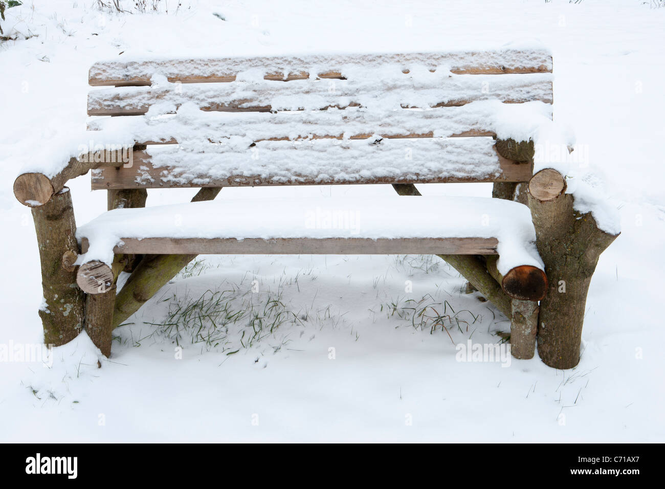 Rustic Garden Bench Made From Old Logs Covered In Snow Winter