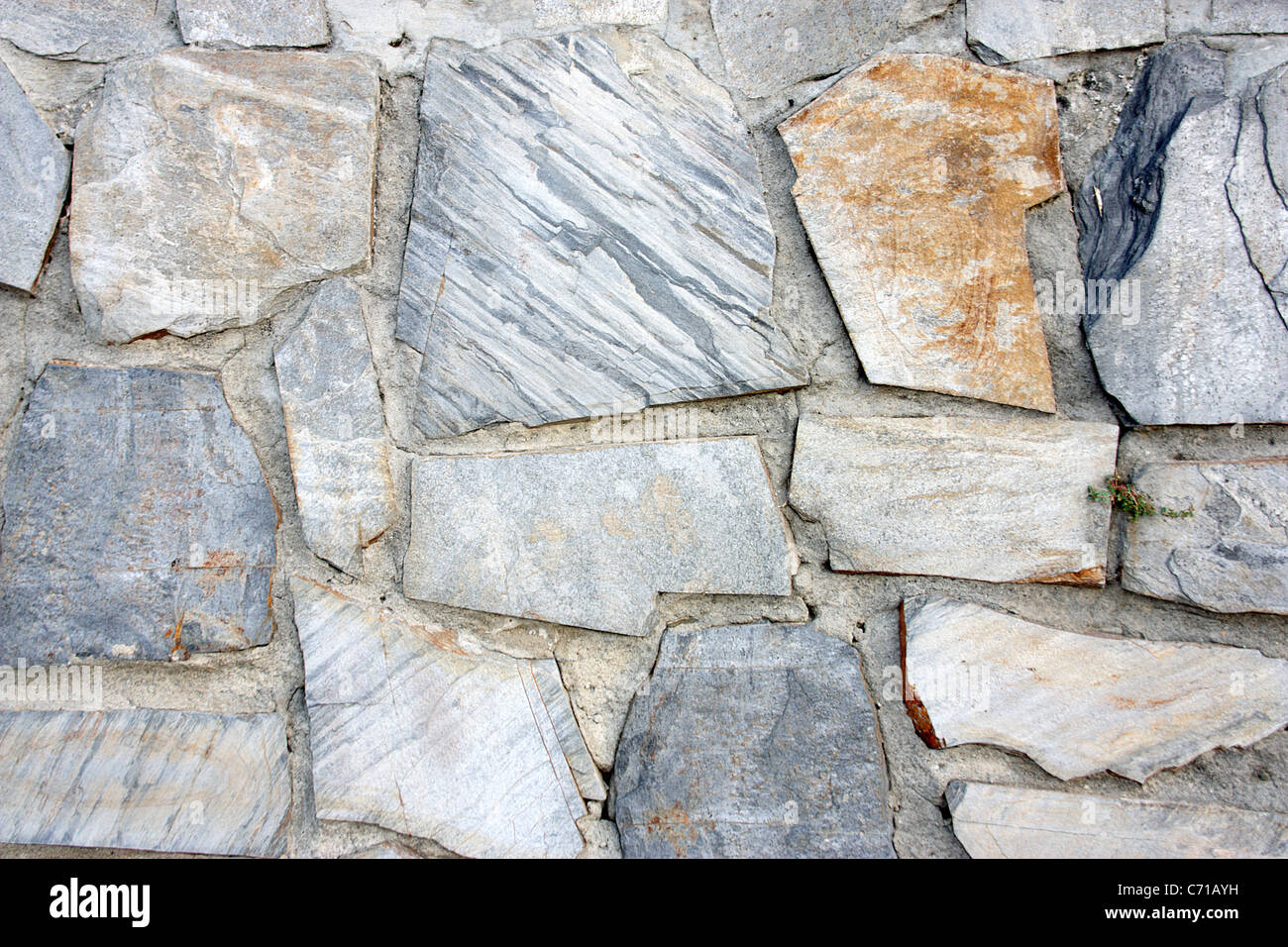 Fund of screen of a wall of gray stones with brown tones in a point of attention. - Stock Image