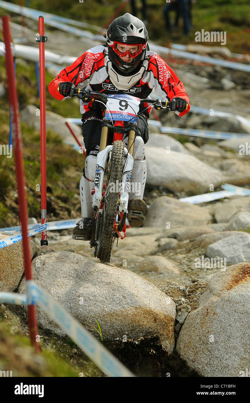 2011 UCI Junior Women's Downhill Mountain Bike World Champion and World Cup Champion Manon Carpenter racing - Stock Image