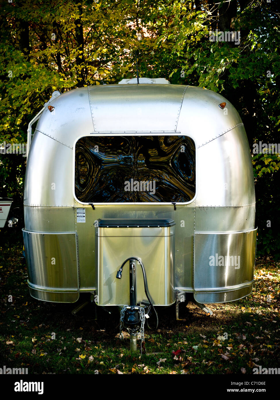 airstream parked in the fall - Stock Image