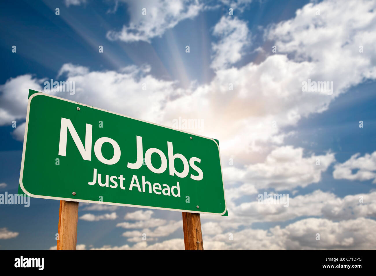 No Jobs Green Road Sign Against Dramatic Sky, Clouds and Sunburst. - Stock Image