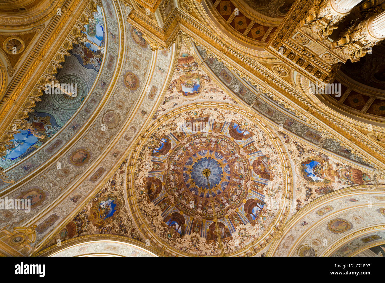 The dome of the Ceremonial Hall of Dolmabahce Palace. The domed and decorated ceiling above the ballroom. Stock Photo