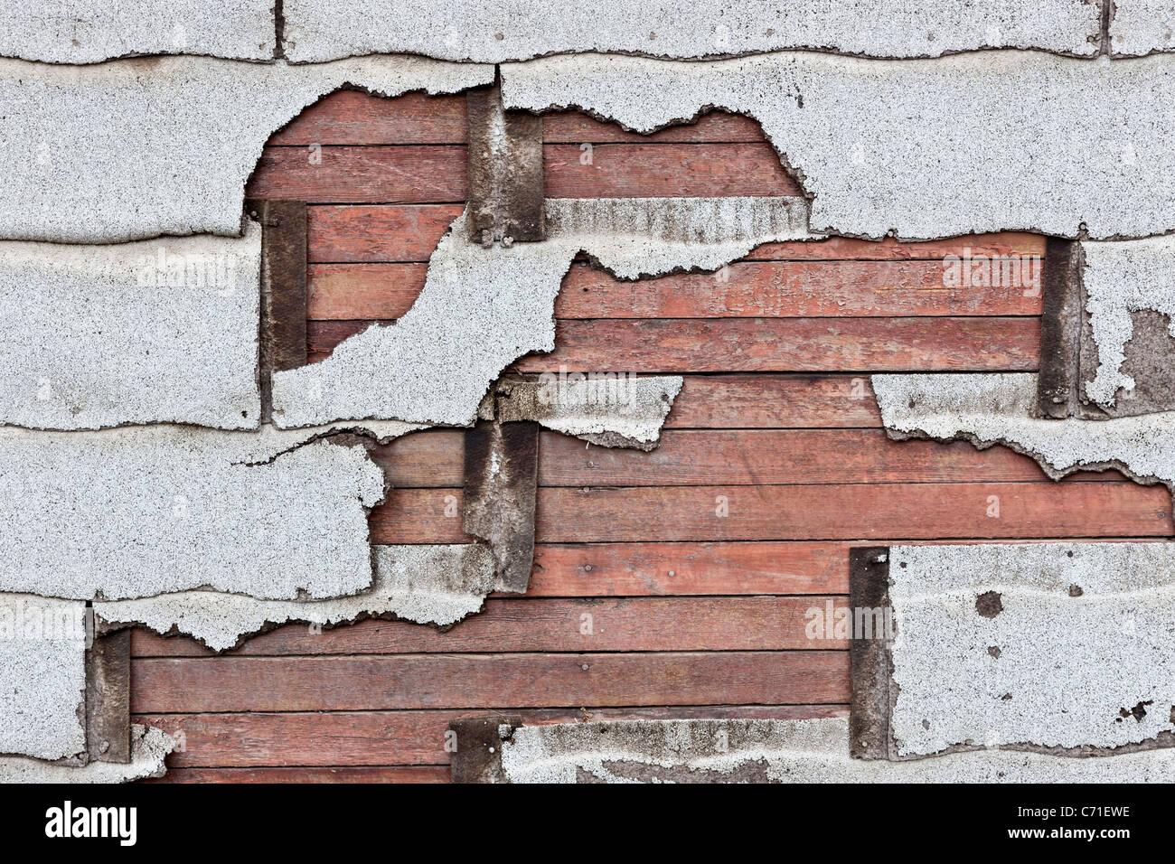 Asbestos composition asphalt shingles deteriorating - Stock Image
