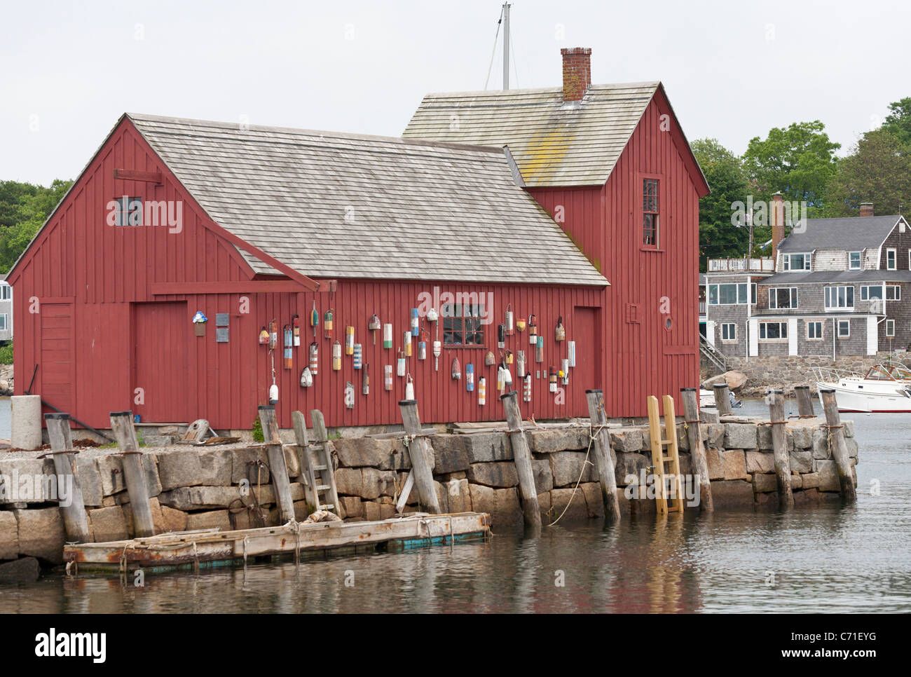 Motif #1 at Rockport. An old red boathouse on the harbor at Rockport is a favorite for artists. - Stock Image