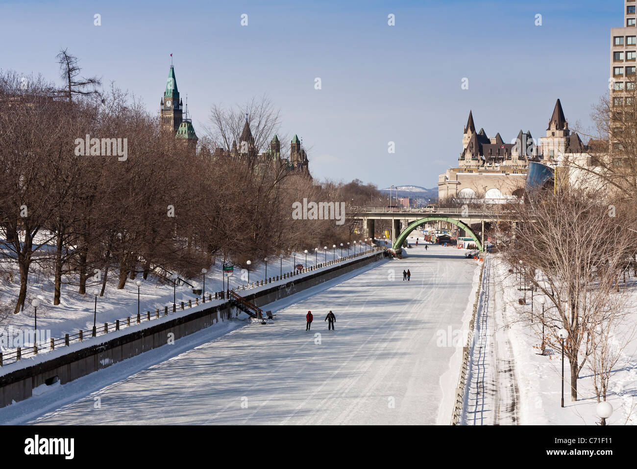 Rideau Canal Skateway on a cold day. A quiet cold day on the Rideau Skateway. Only a few skaters and walkers are - Stock Image