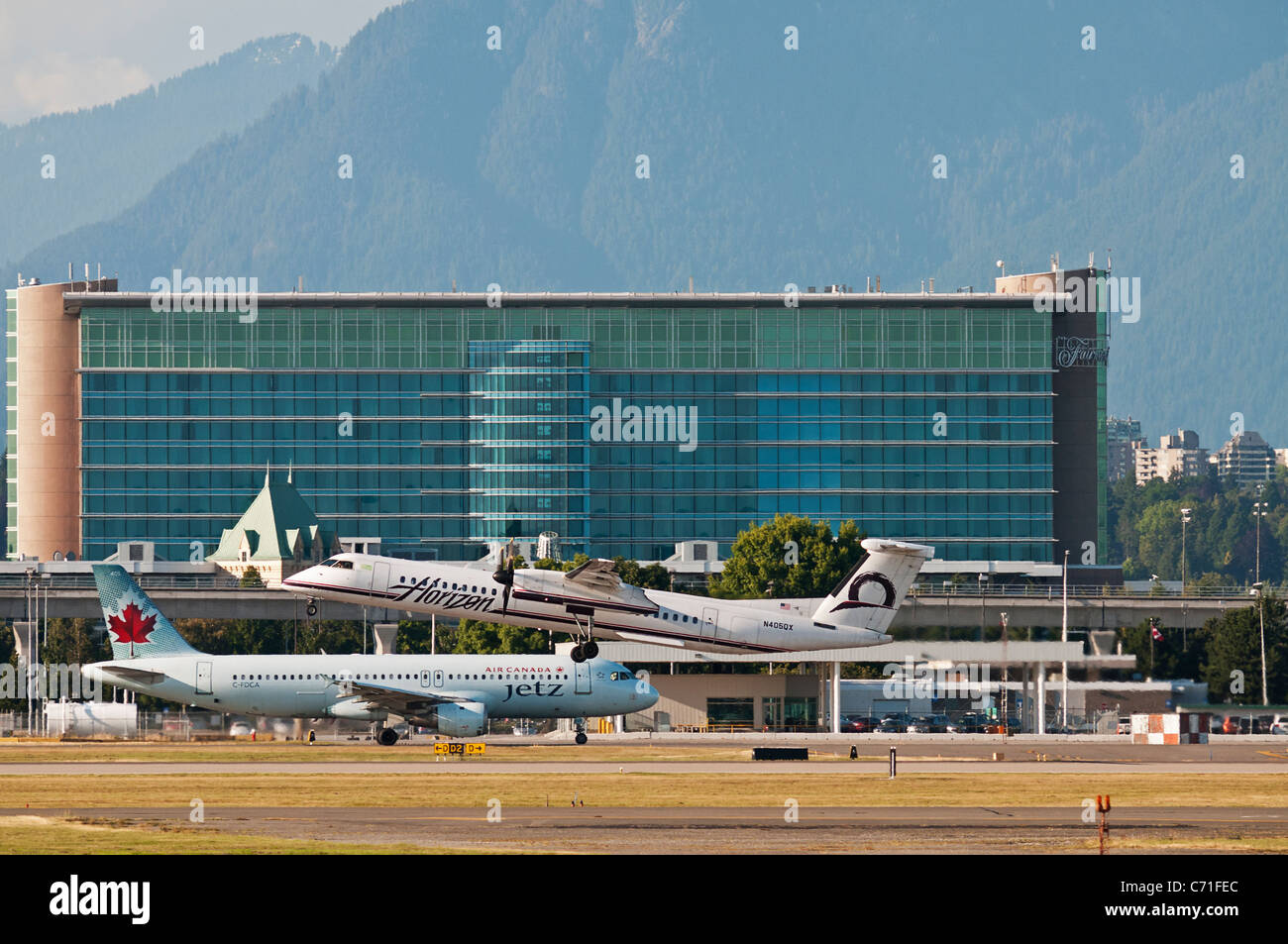 Airliners: Horizon Air Bombardier Dash 8 and an Air Canada Airbus Jetz Airbus A320 at Vancouver International Airport, - Stock Image