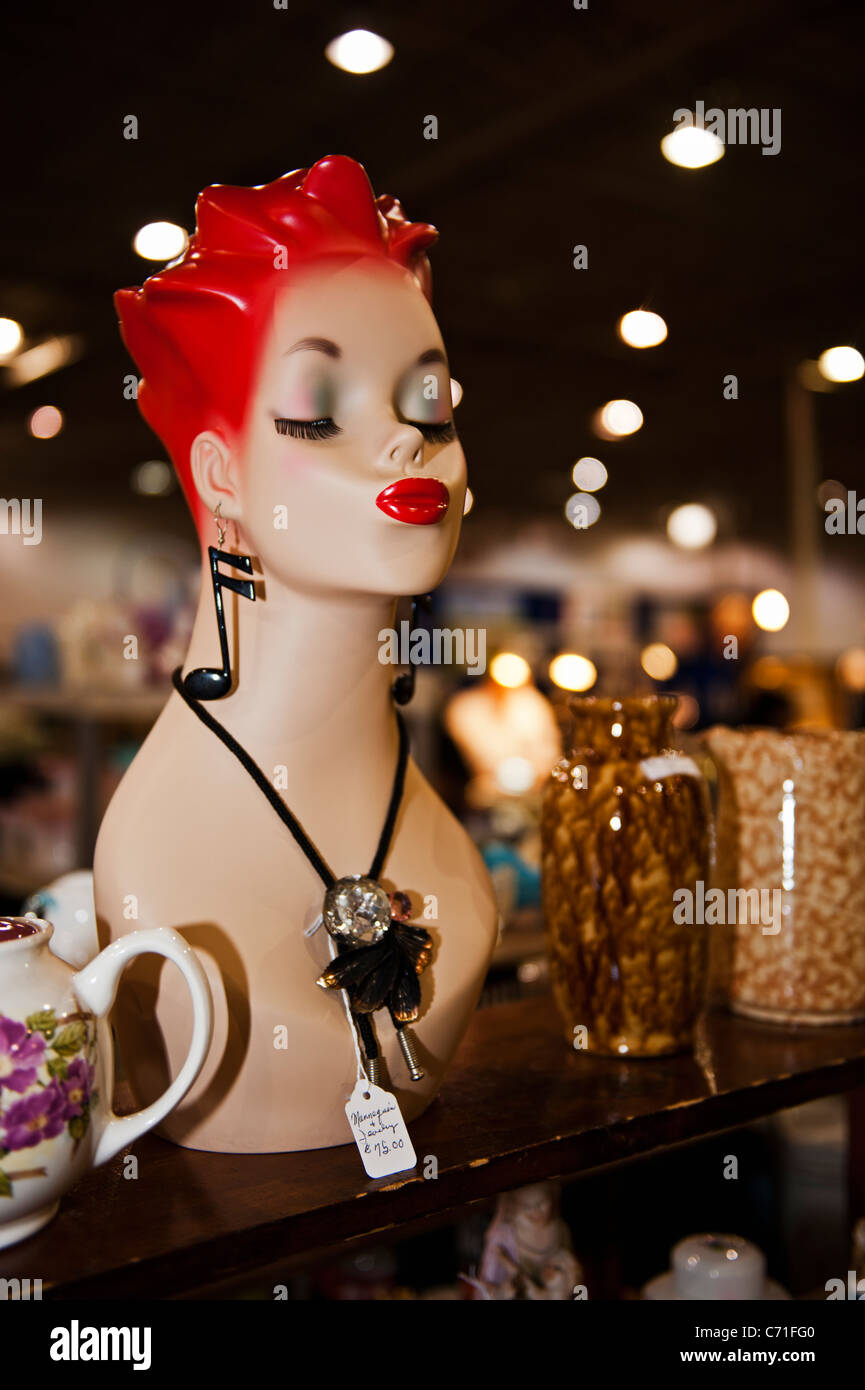 Art deco manikin bust with pop-culture costume jewelry for sale at an indoor flee market in Northern Virginia - Stock Image