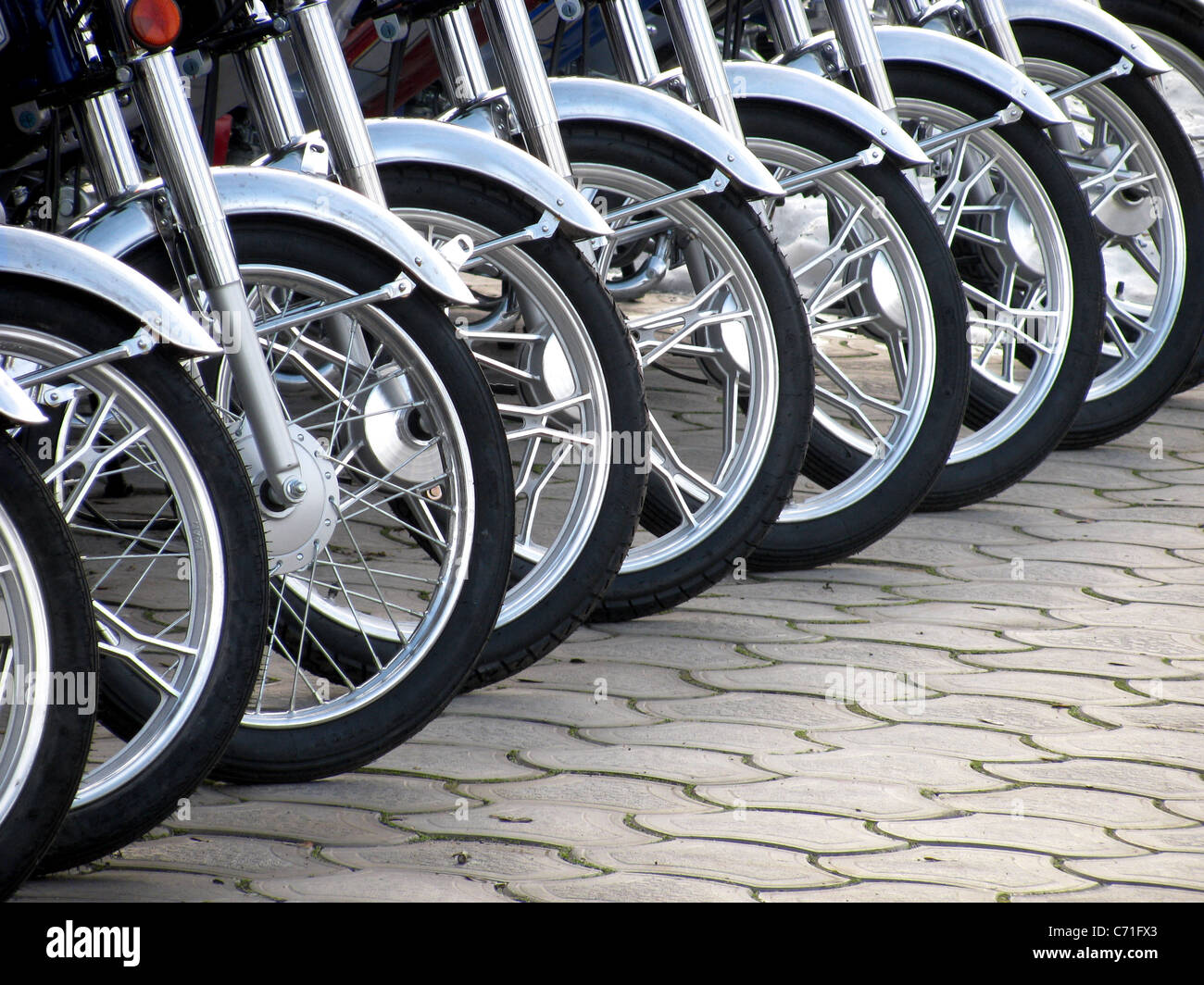 row of motorcycle wheels - Stock Image