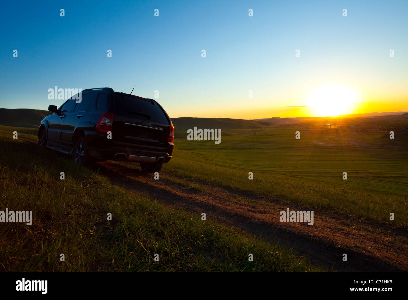 car driving away towards sunset stock photo 38759145 alamy