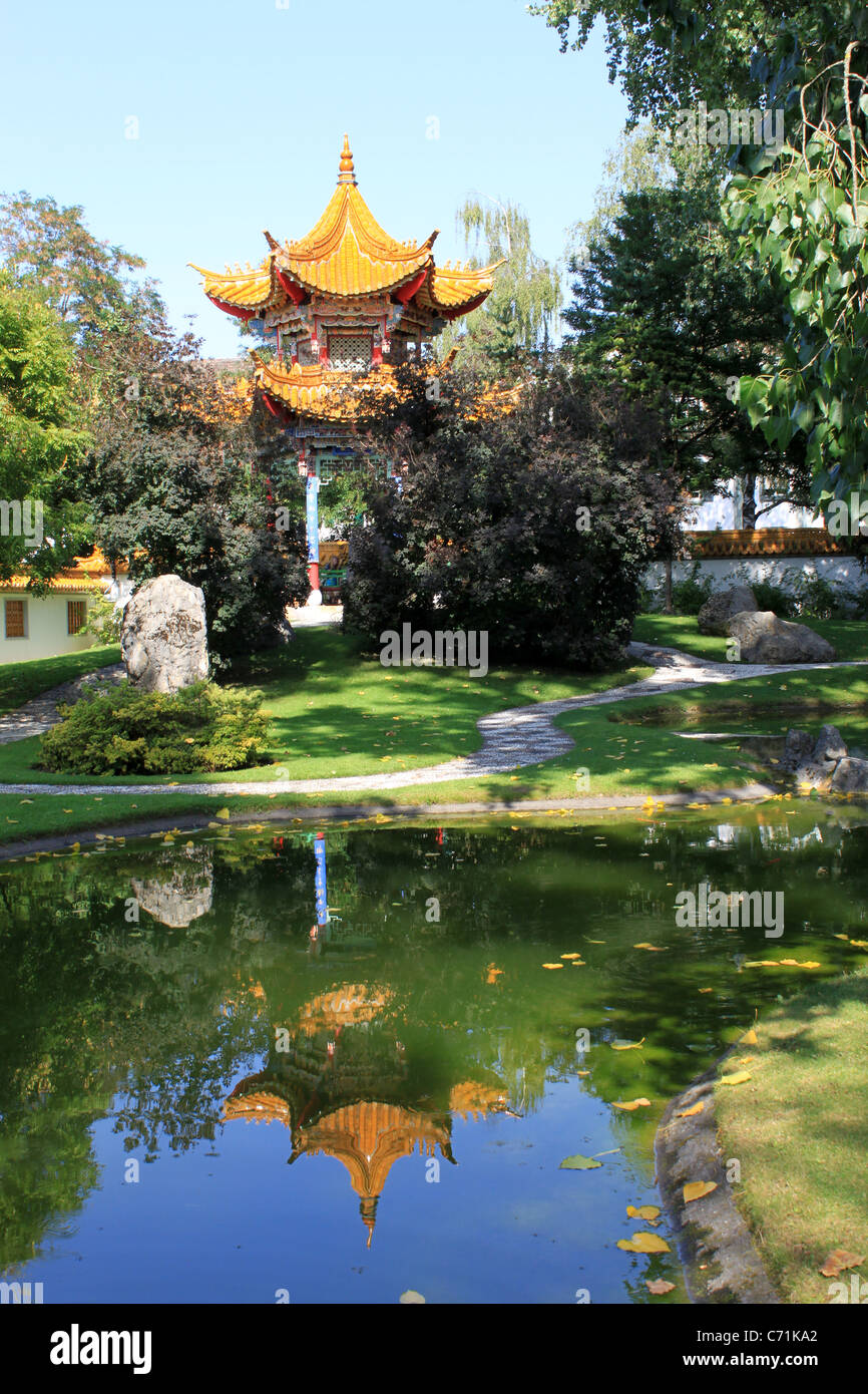 the hectagon pavilion and reflection in pond chinese garden zurich