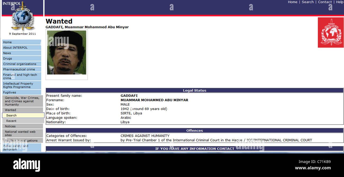 Screen shot of Interpol website calling for the arrest of fugitive former Libyan leader Muammar Gaddafi - Stock Image