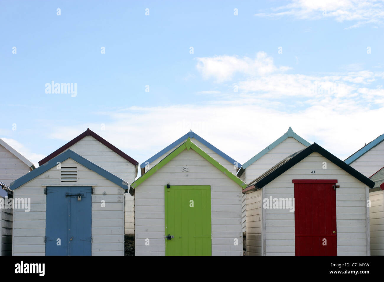 Beach Huts on the Promenade, Paignton, Devon, UK - Stock Image
