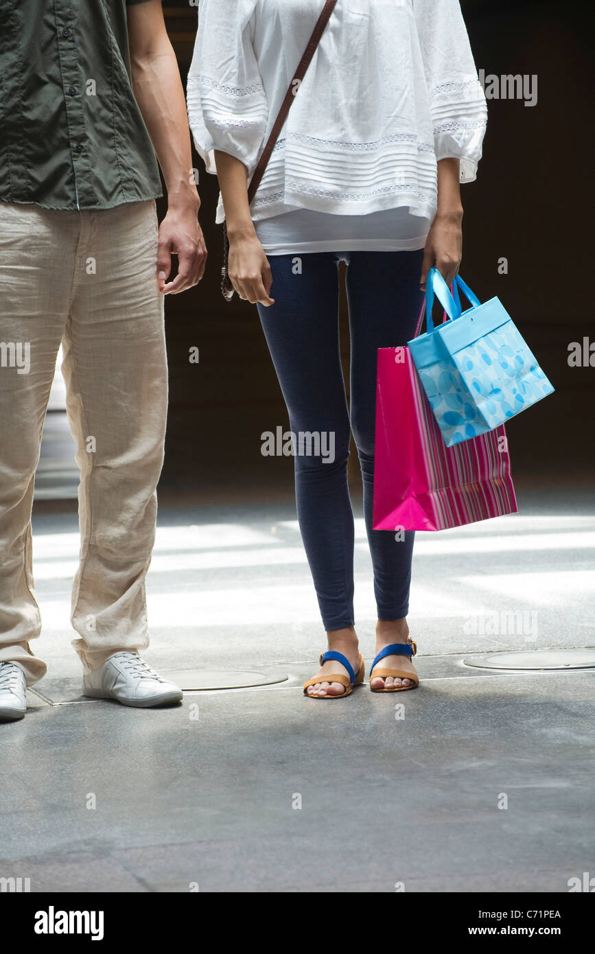 Couple with shopping bags, cropped - Stock Image