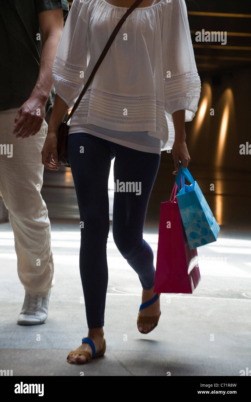 People walking on shopping bags, cropped - Stock Image