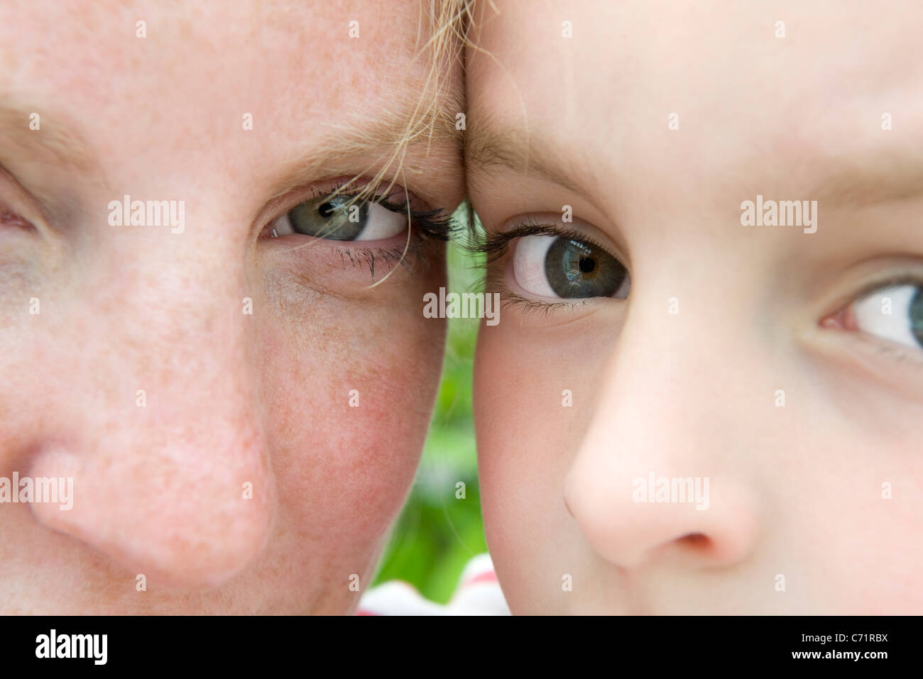 Mother and young son, close-up portrait - Stock Image