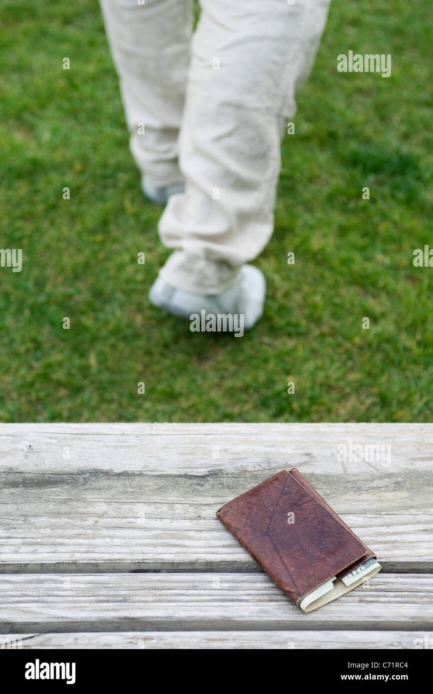 Wallet left on park bench - Stock Image