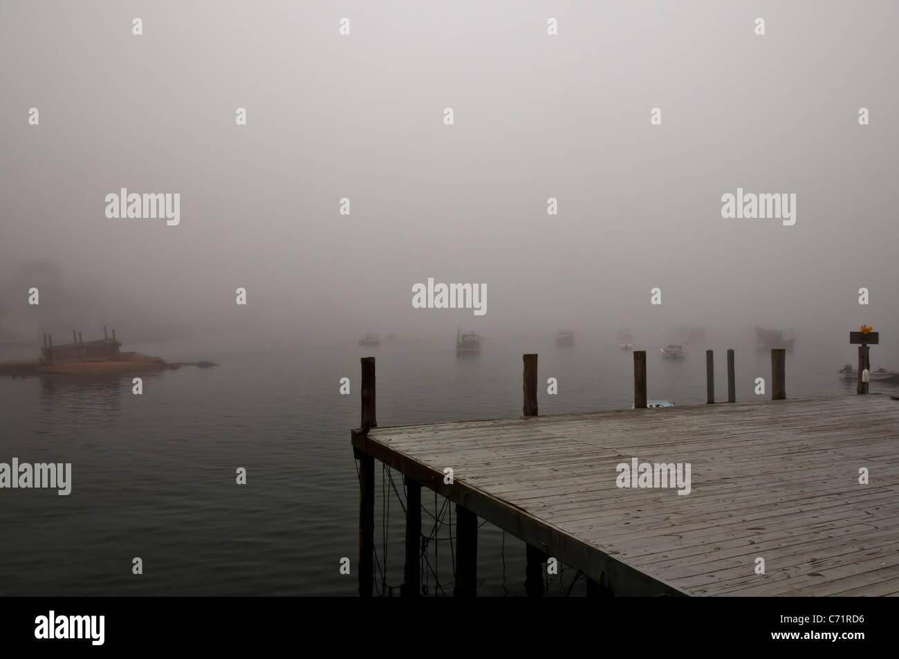 Fog Stonington Harbor Maine - Stock Image