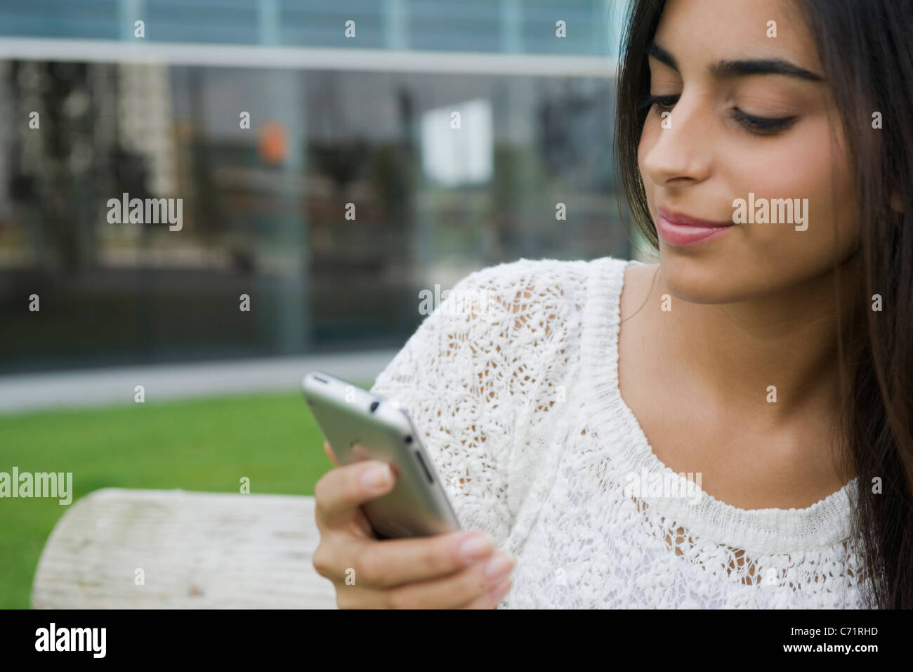 Woman text messaging - Stock Image