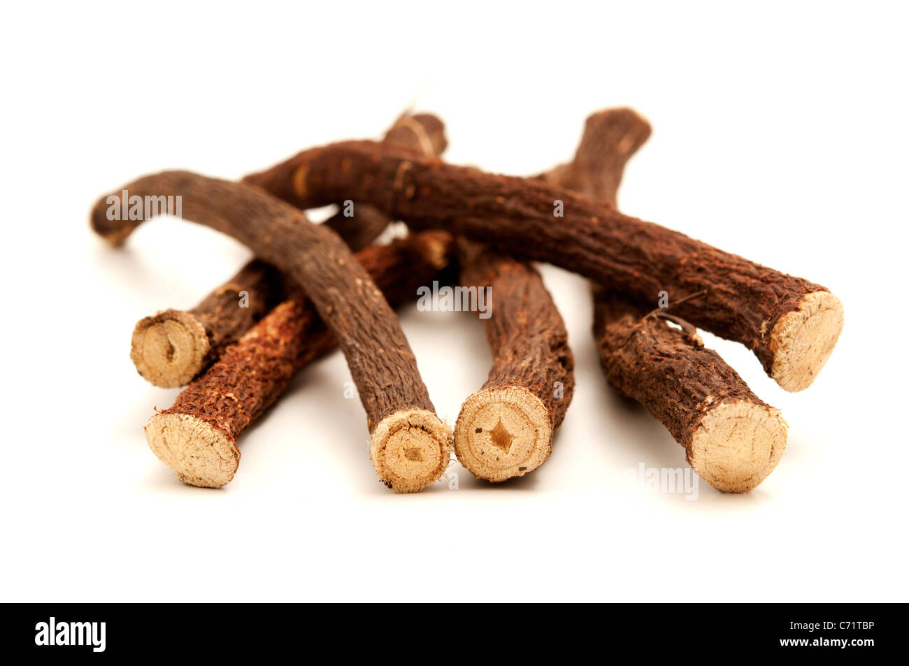 Liquorice roots on a white background - Stock Image