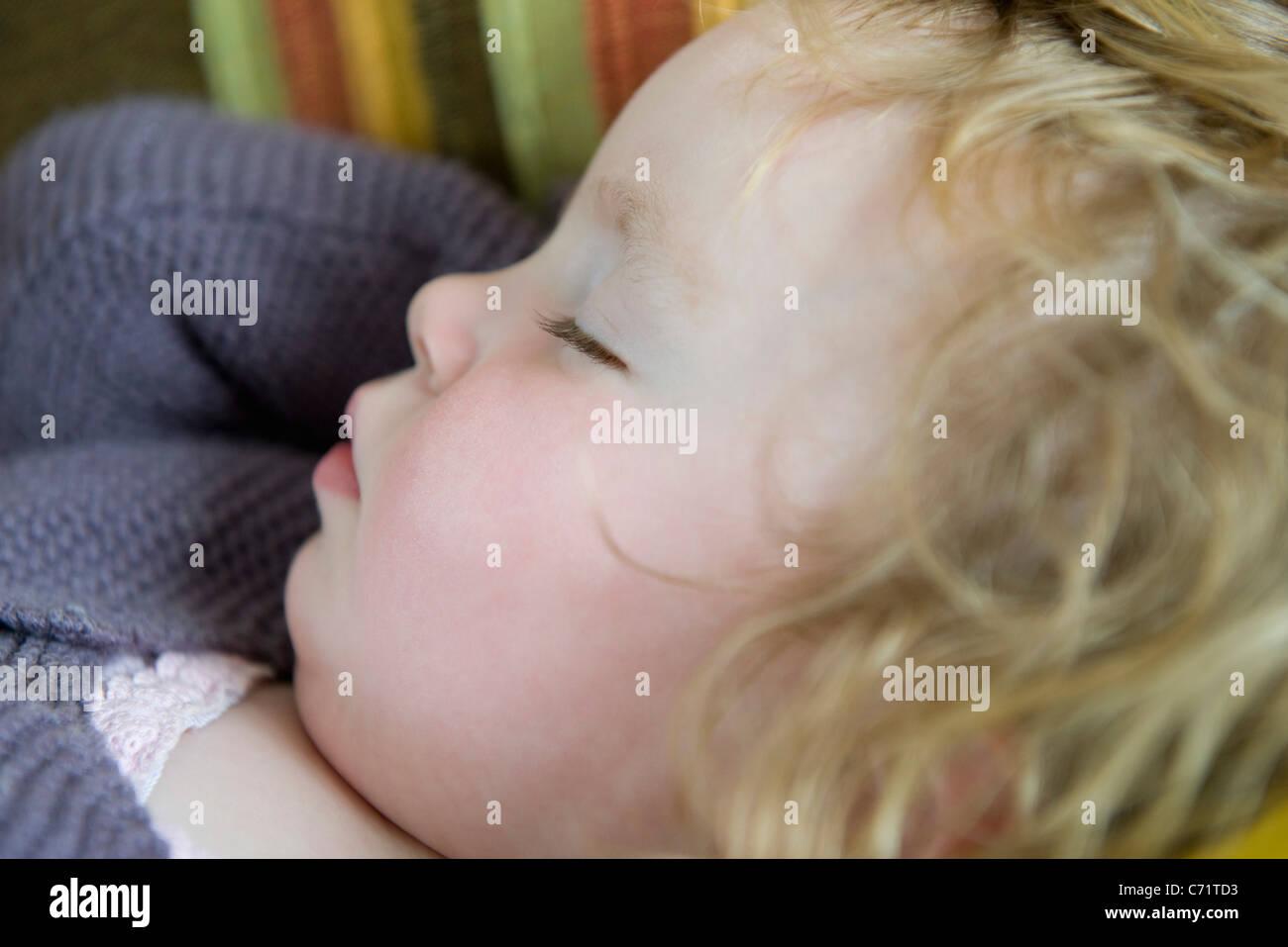 Baby girl sleeping, portrait - Stock Image