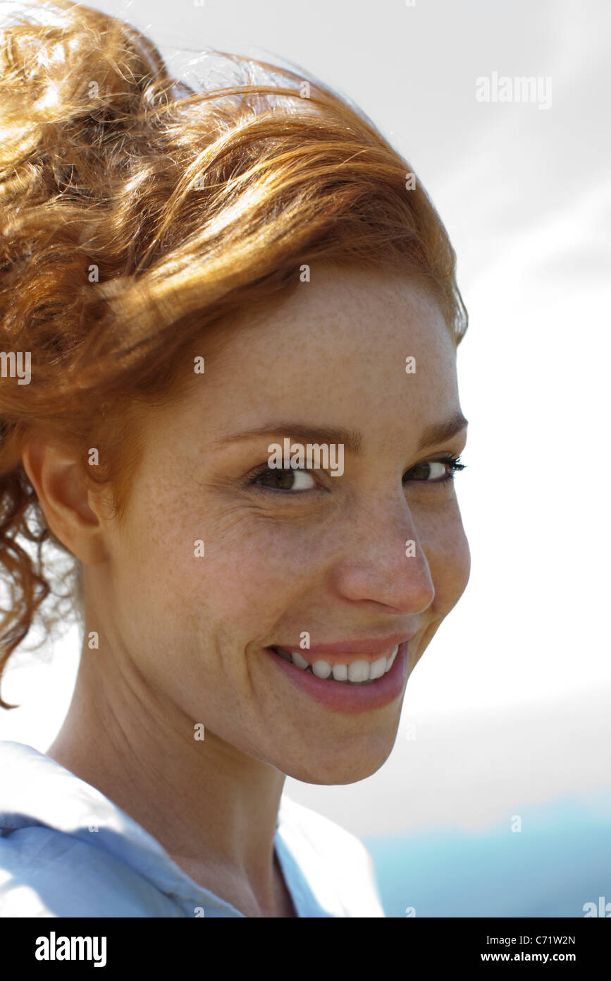 Redheaded woman, portrait - Stock Image