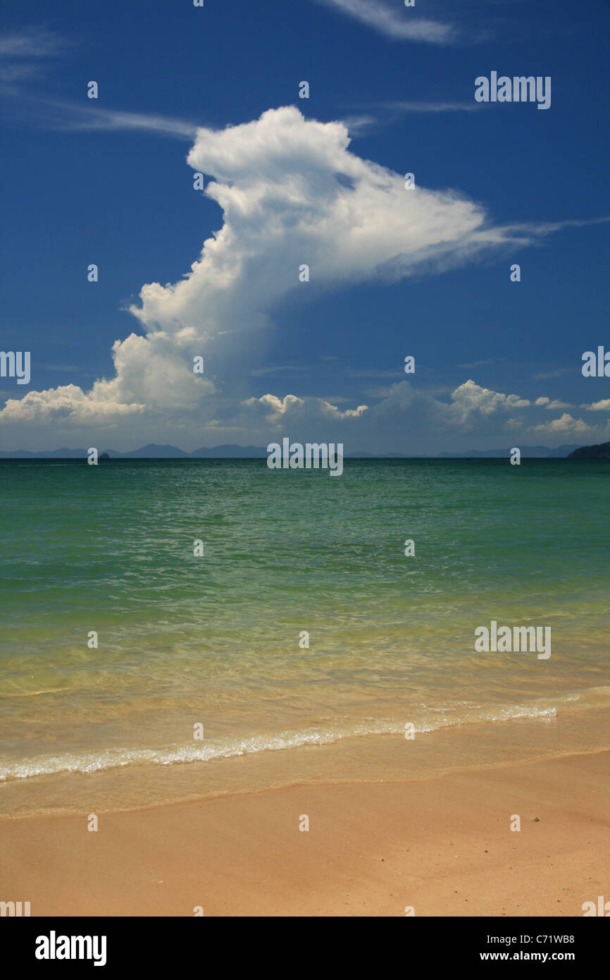 tropical beach in Thailand with towering white cloud - Stock Image