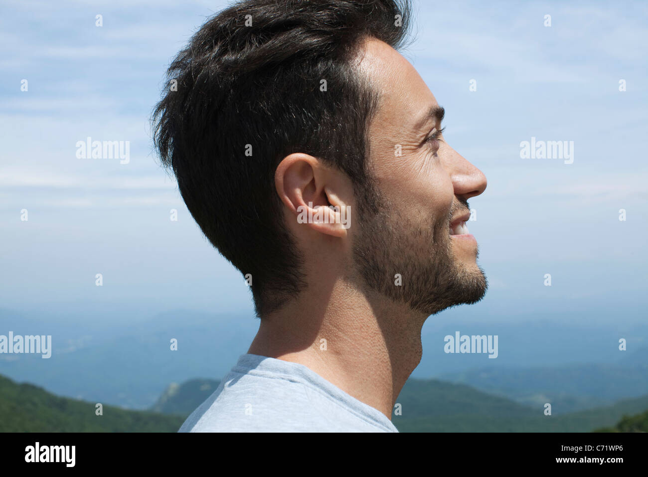 Man looking at scenic view, profile - Stock Image