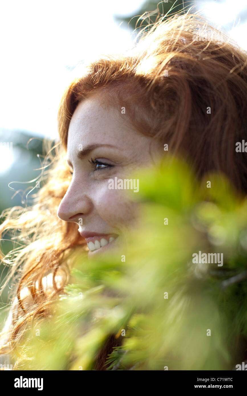 Young woman in nature, cropped - Stock Image