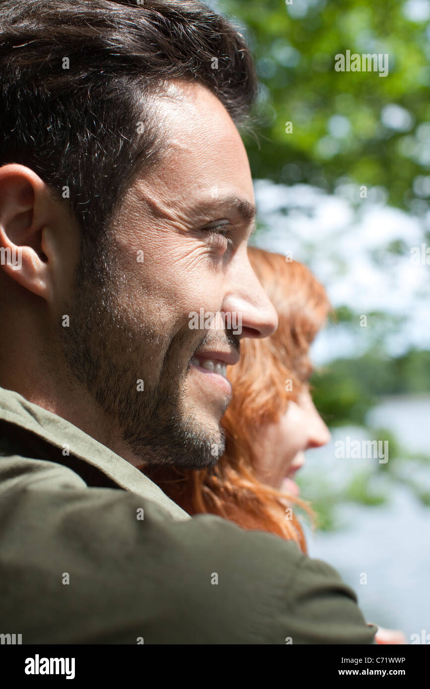Smiling mid-adult man in nature - Stock Image