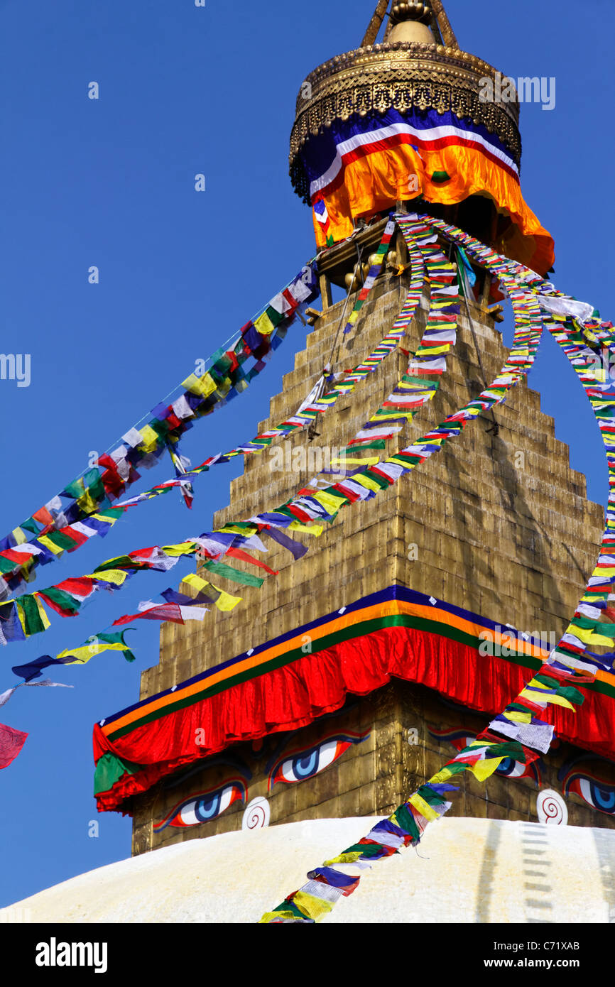 Buddhist stupa and prayer flags at Bodhnath, Kathmandu, Nepal - Stock Image