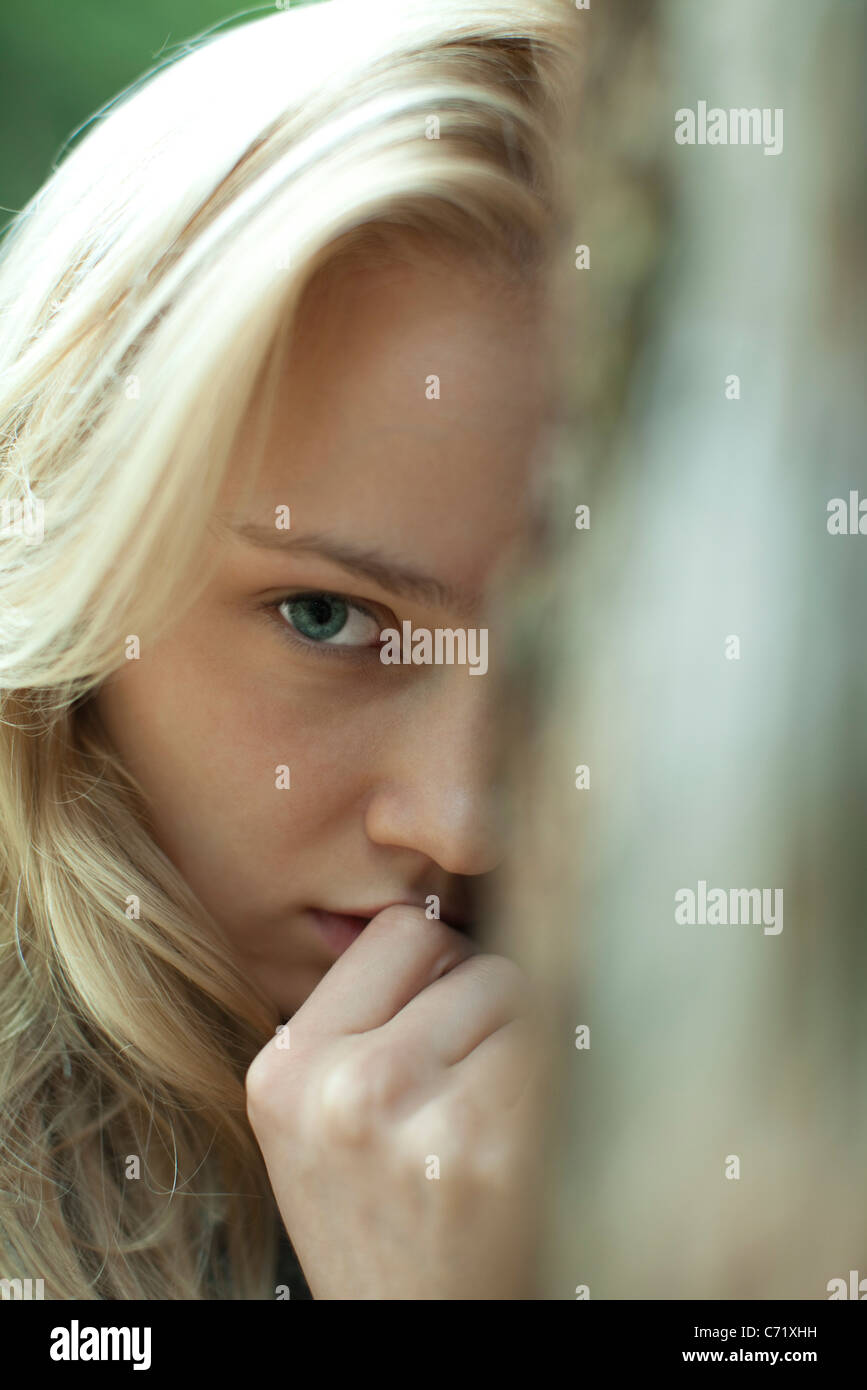 Young woman with serious expression, cropped - Stock Image