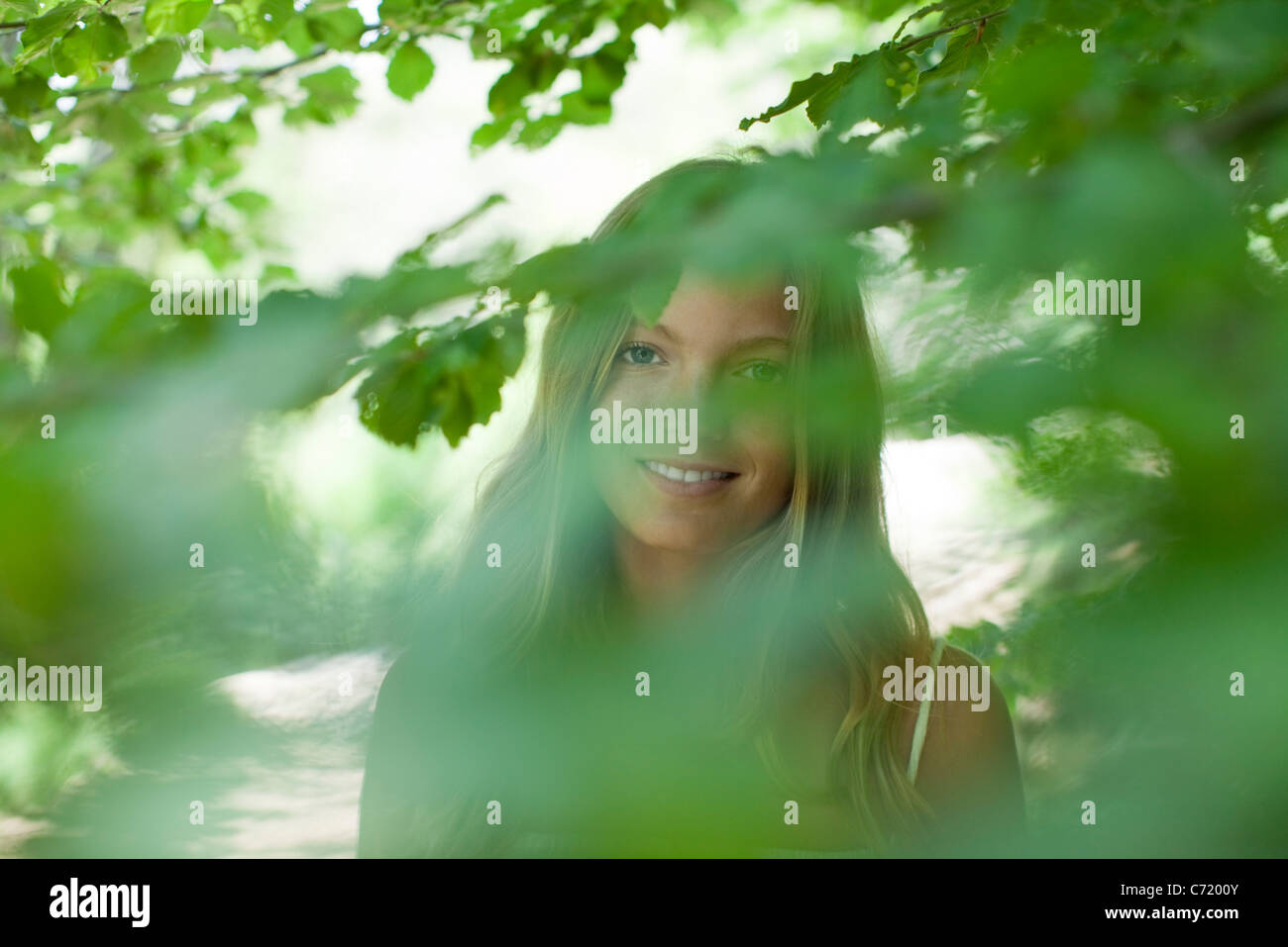 Young woman in nature, selective focus - Stock Image