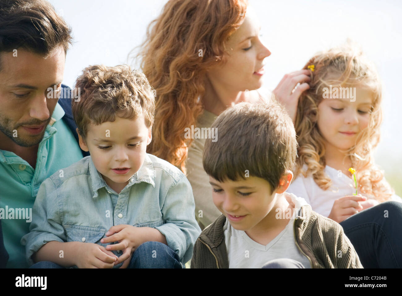 Family relaxing together outdoors - Stock Image