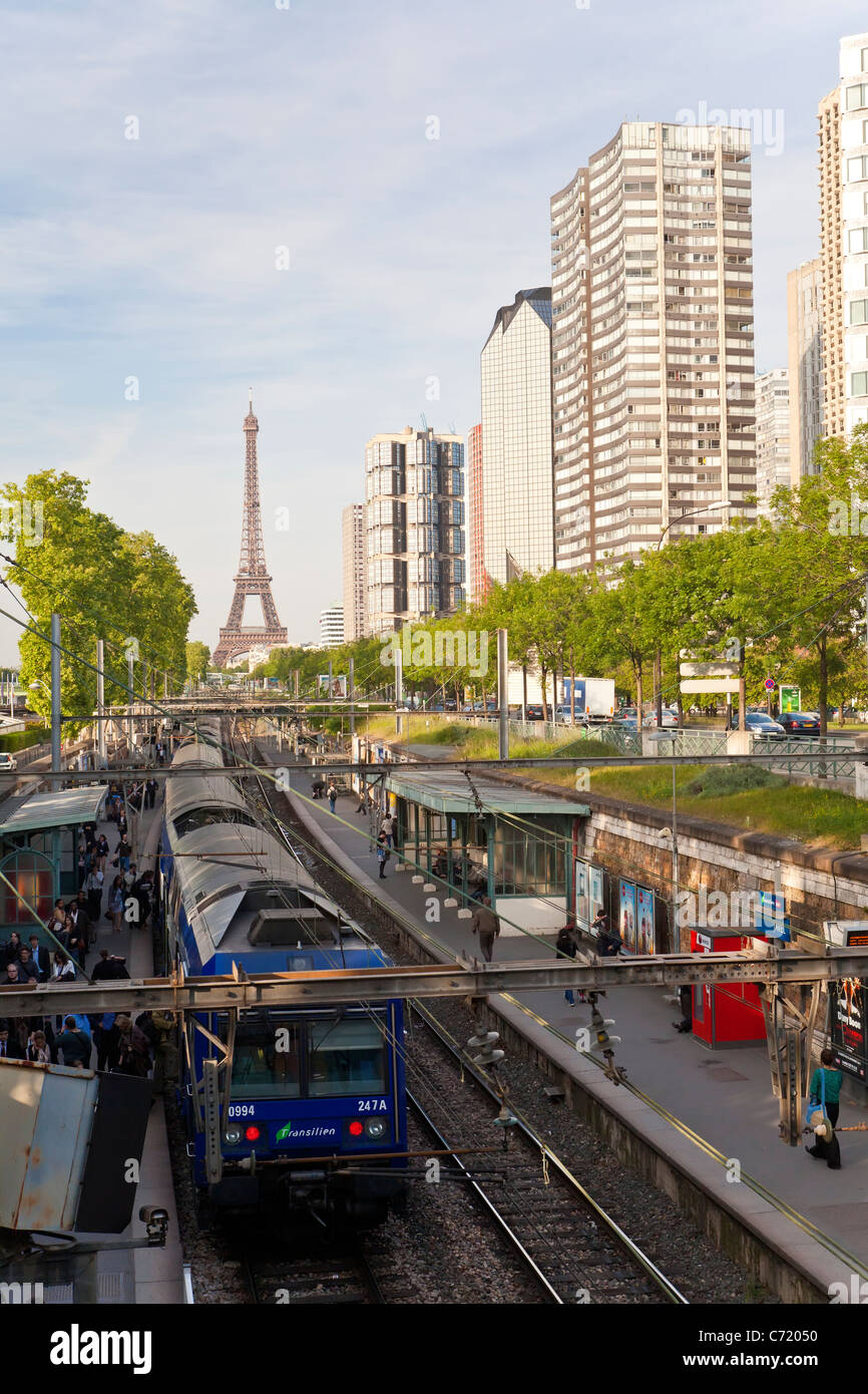 France, Paris, Train Station with High-rise Buildings on the Left Bank and Eiffel Tower - Stock Image