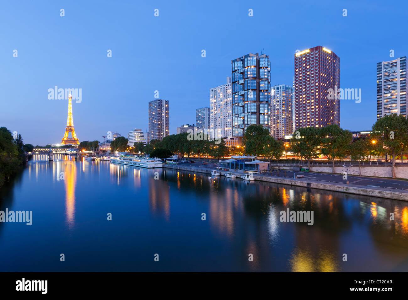 France, Paris, Night View Of River Seine With High-rise Buildings On The Left Bank And Eiffel Tower - Stock Image