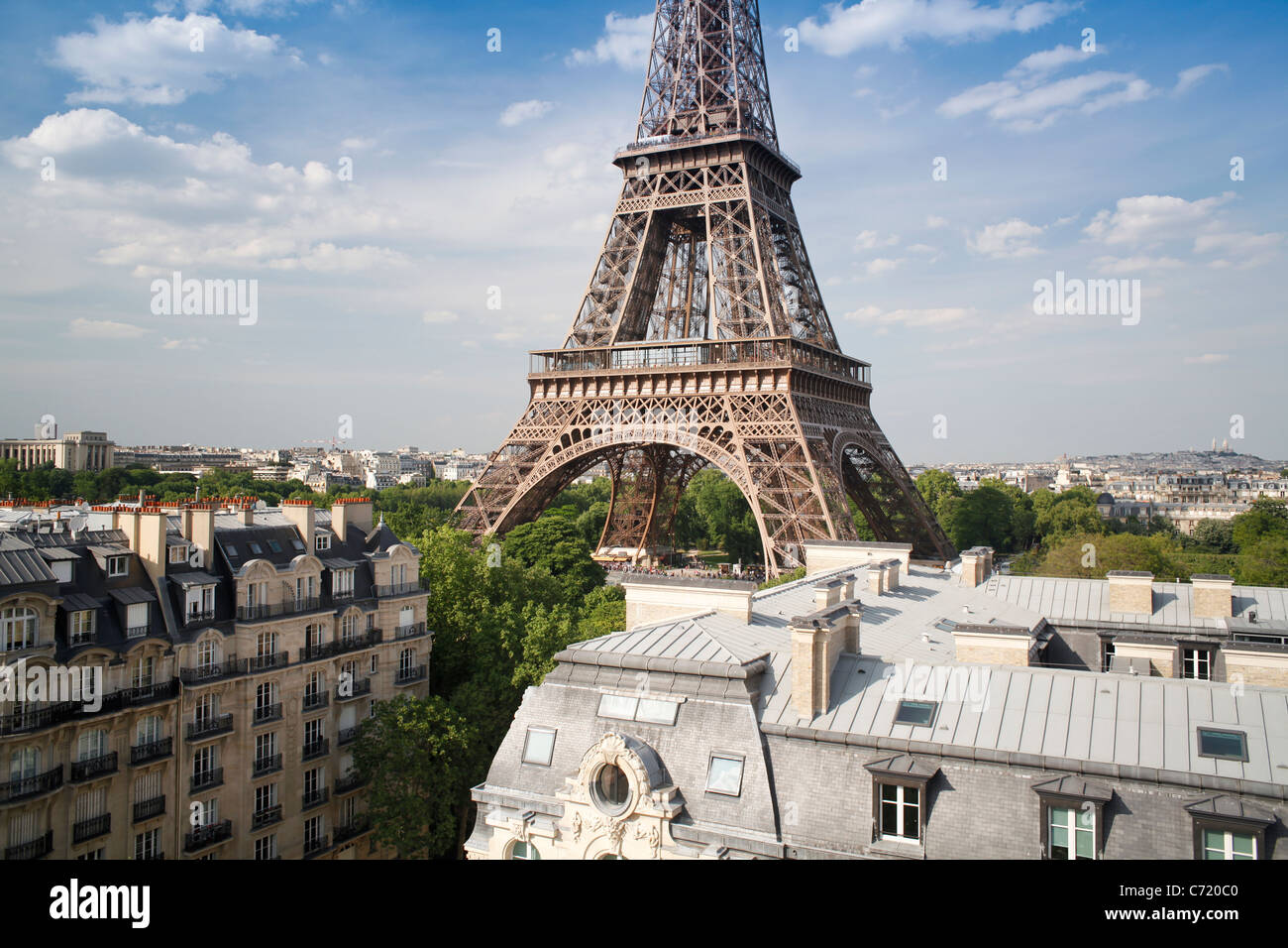 France, Paris, Eiffel Tower, viewed over rooftops - Stock Image