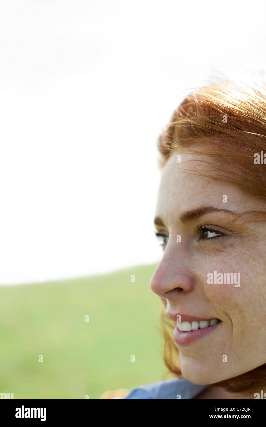 Woman outdoors, looking away, portrait - Stock Image