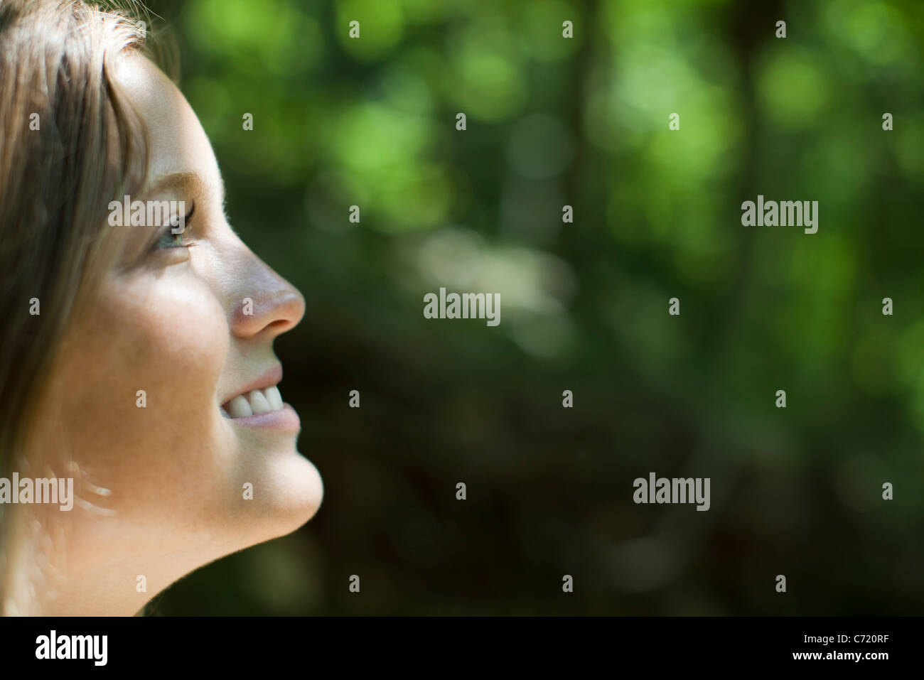 Young woman in nature, side view - Stock Image