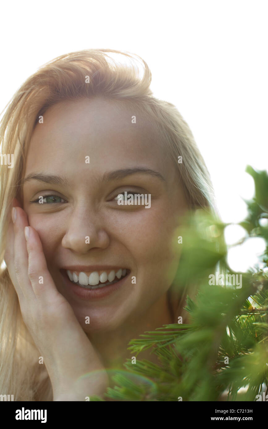 Smiling young woman, portrait - Stock Image