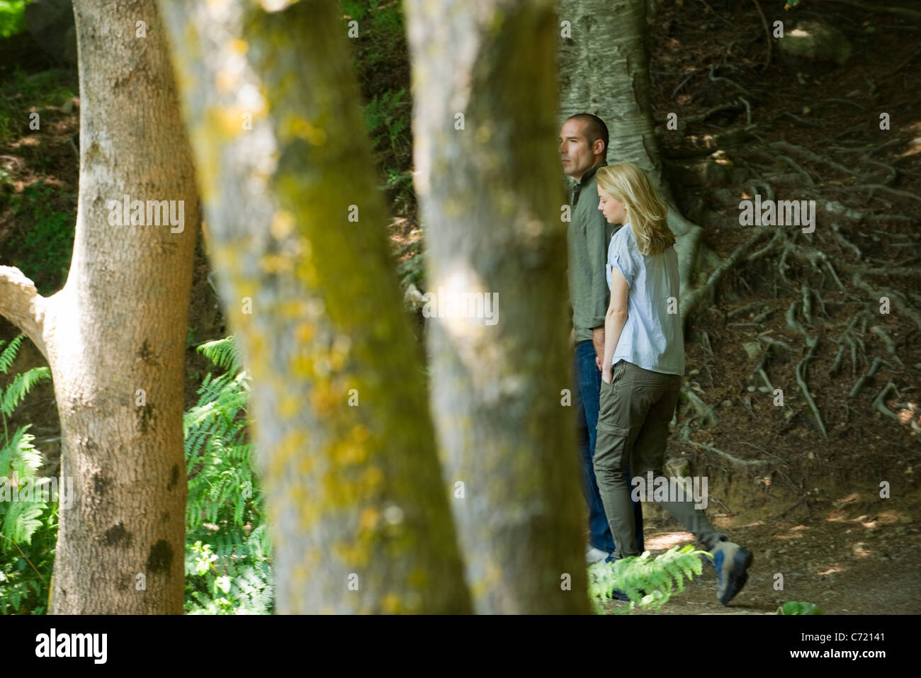 Couple walking in woods Stock Photo