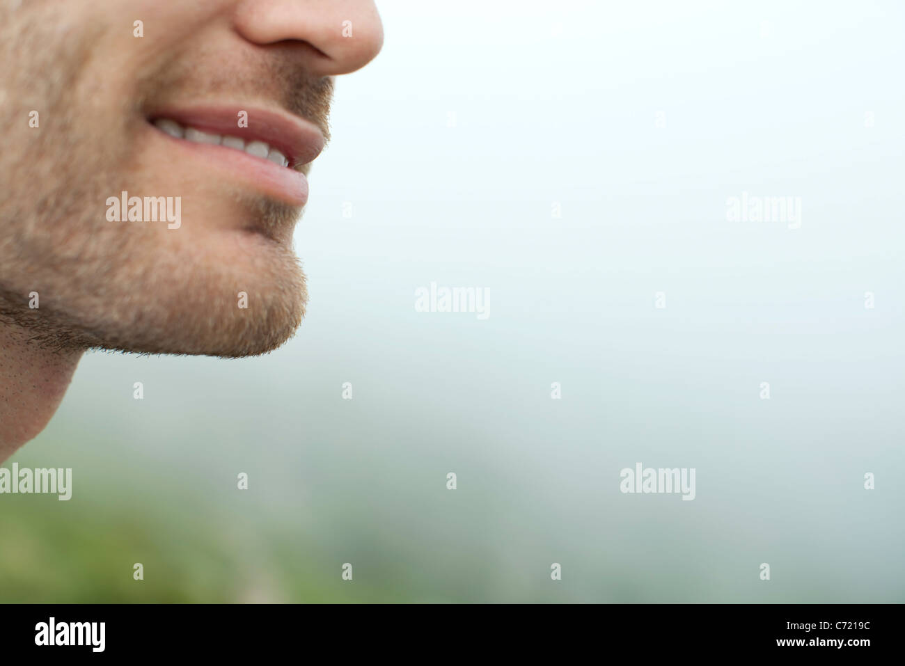 Man's mouth and chin, close-up, cropped - Stock Image