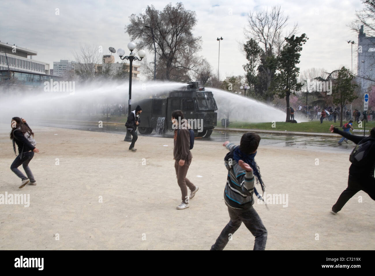 Water cannon in action during a student protest in Santiago de Chile - Stock Image