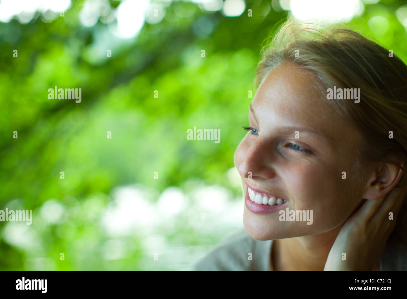 Young woman in nature, portrait - Stock Image