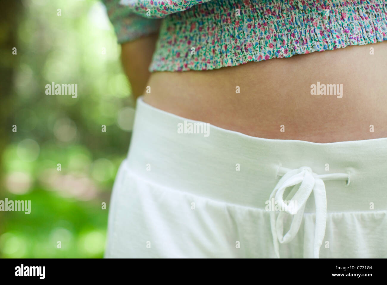 Young woman's abdomen, mid section - Stock Image