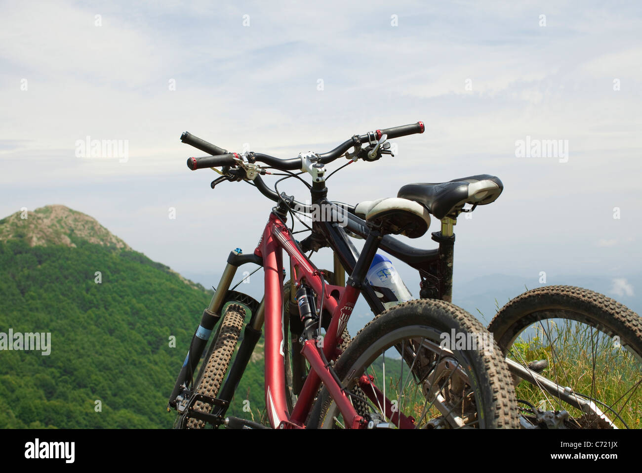 Mountain bikes against view of mountain - Stock Image